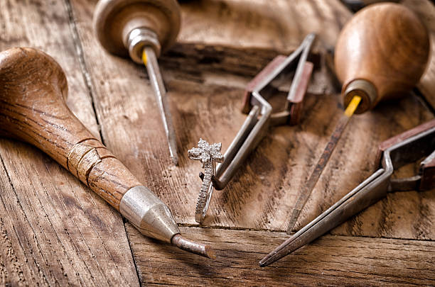 Goldsmith's tools Still life of goldsmith's tools with diamonds ring jeweller stock pictures, royalty-free photos & images