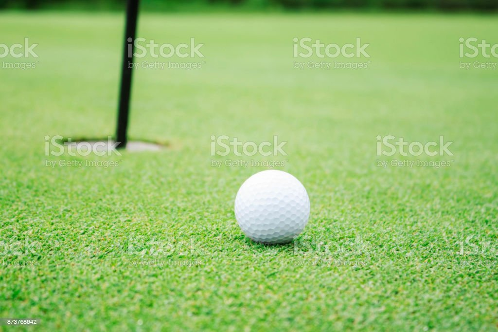 Golf and holes on lawn. stock photo