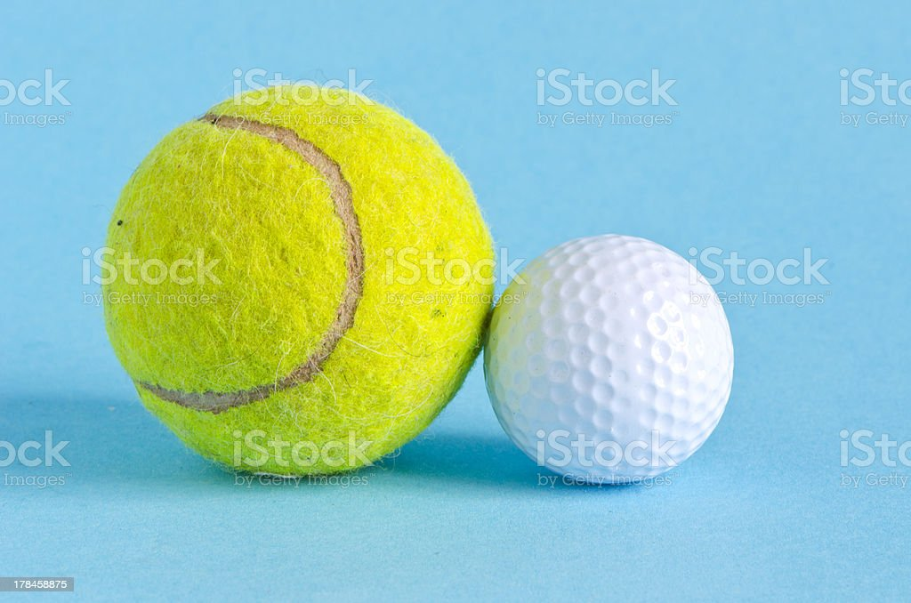 golf and tennis balls on azure background stock photo
