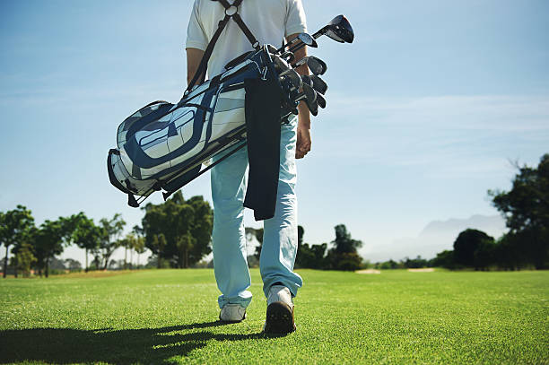 golf bag man stock photo
