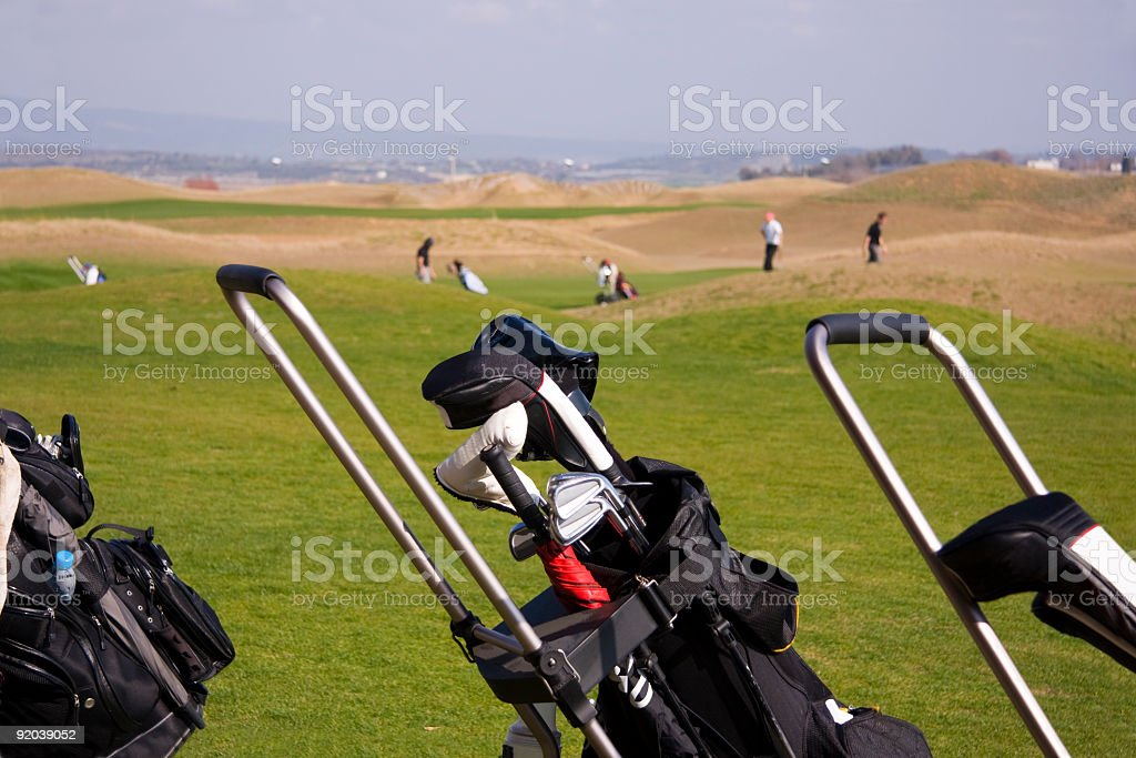 Golf bag with clubs, on a golfcourse