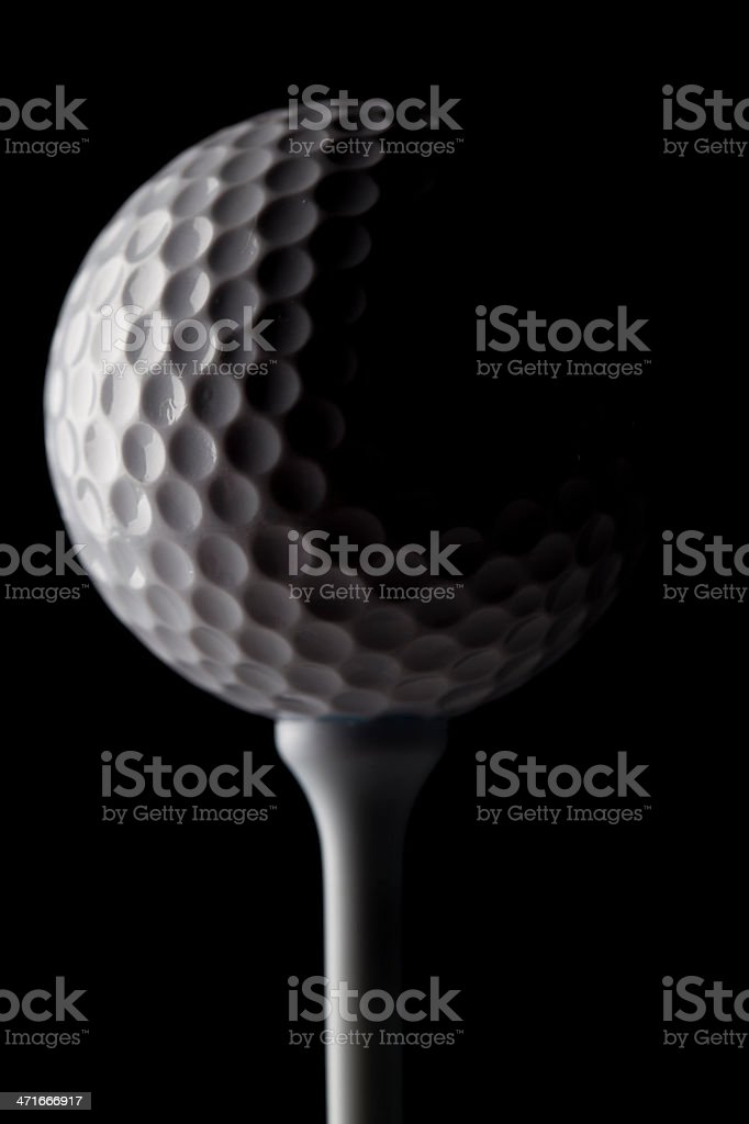 Golf ball against black background royalty-free stock photo