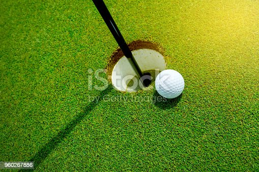 istock Golf ball almost in the hole on the grass 960267886