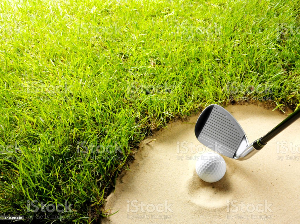 Golf Ball and Club in a Sand Bunker royalty-free stock photo