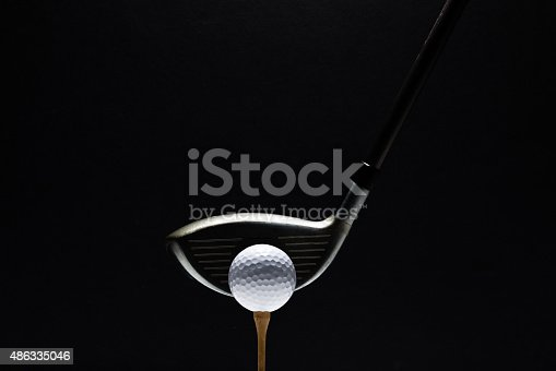 A close up of a golf ball and golf club at address on a black background. http://blog.michaelsvoboda.com/GolfBanner.jpg