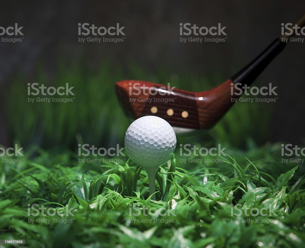 golf ball and driver on green grass royalty-free stock photo