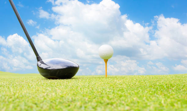 f034559672f6d Golf ball and golf ball on the field. stock photo