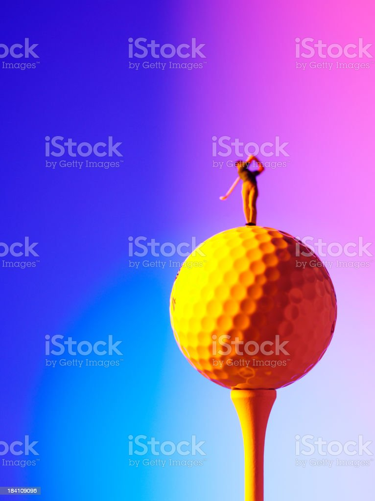 Golf Ball and Golfer Swinging a Club royalty-free stock photo