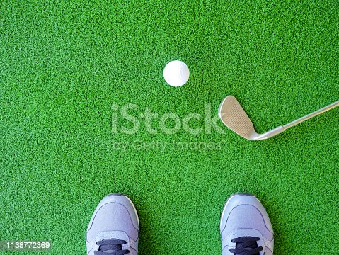 825397576 istock photo Golf ball and iron golf club with golfer 1138772369