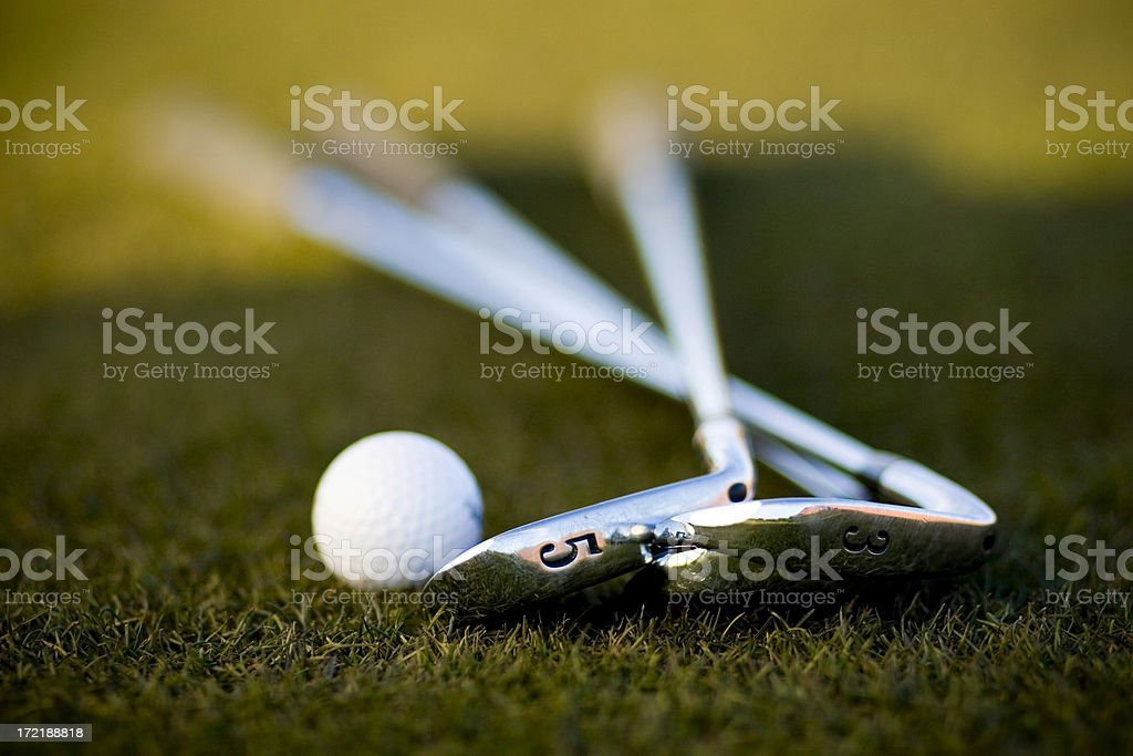 Golf Ball and Irons stock photo