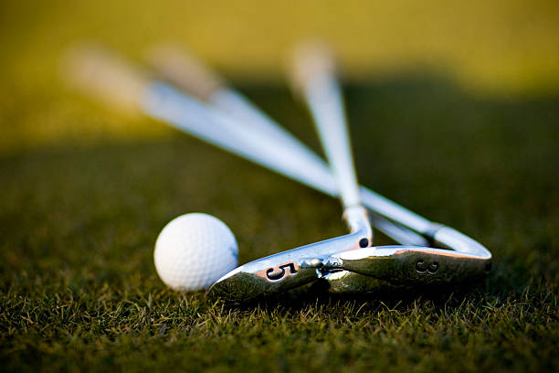 golf ball and irons - golf clubs stock photos and pictures