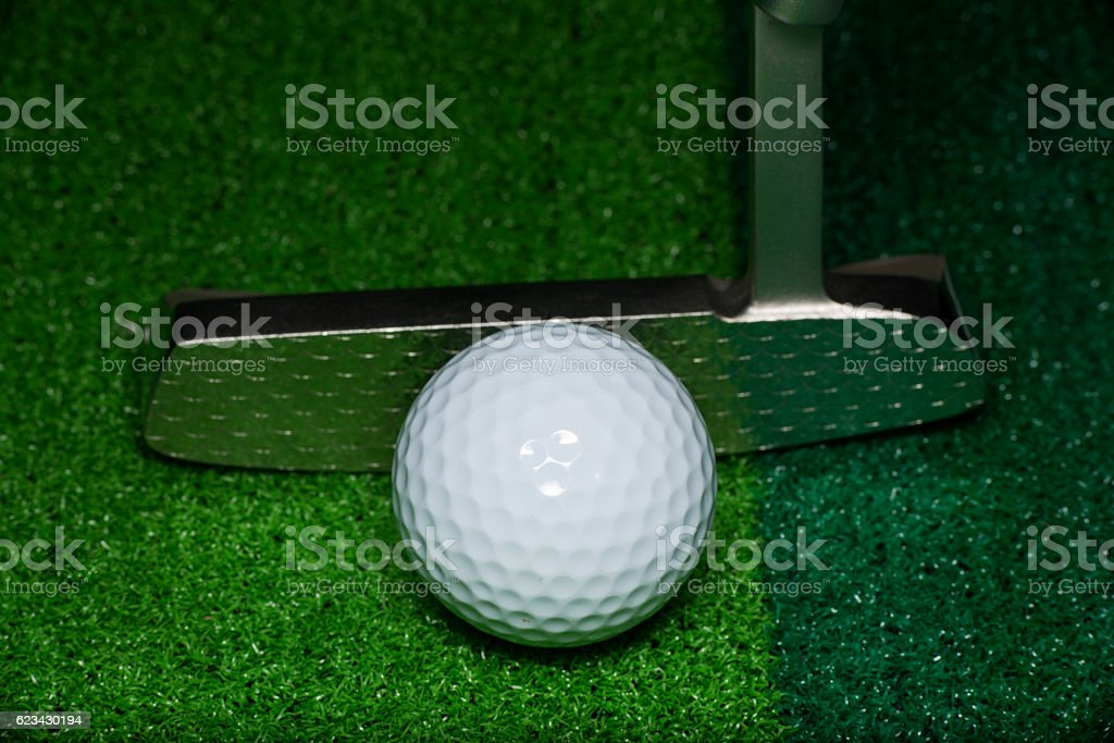 Golf Ball and Putter stock photo