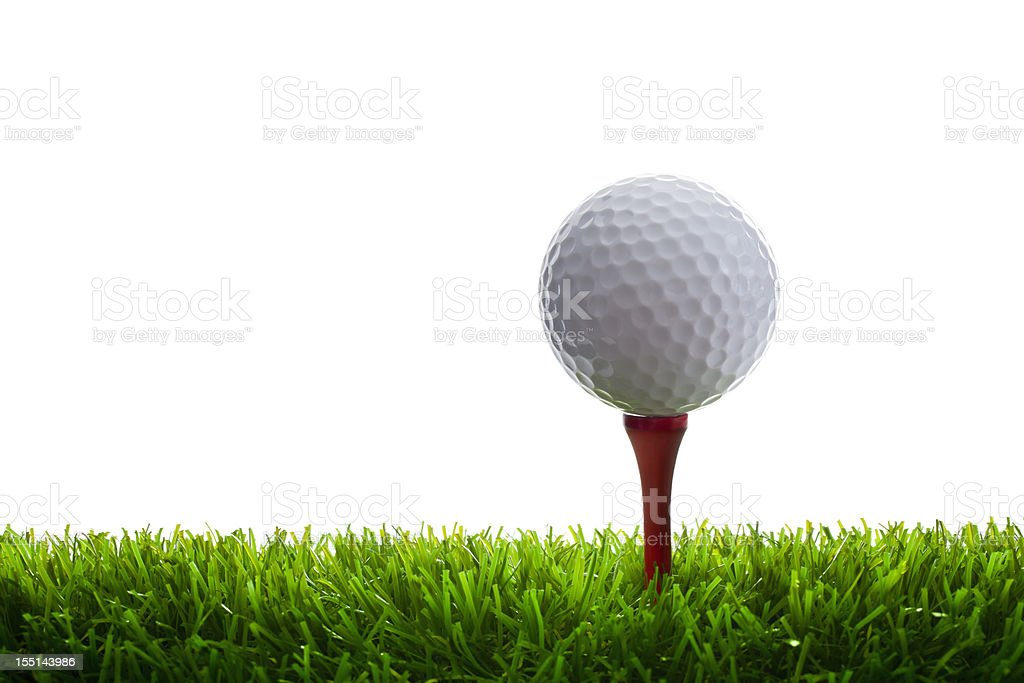 Golf Ball and Tee on grass stock photo