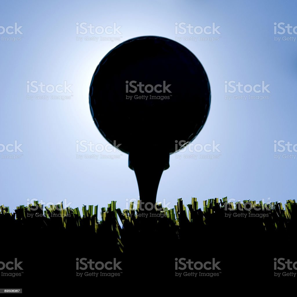 Golf ball at sunset royalty-free stock photo