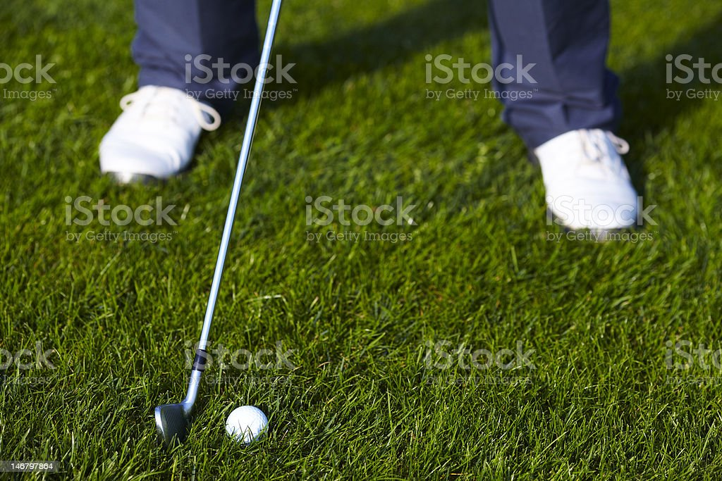 Golf Ball Before The Swing Between Legs Stock Photo