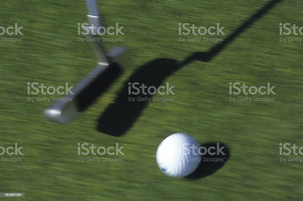 golf ball being putted royalty-free stock photo