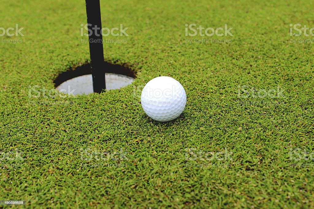 Photo showing the fine carpet of green grass at a putting green on a...