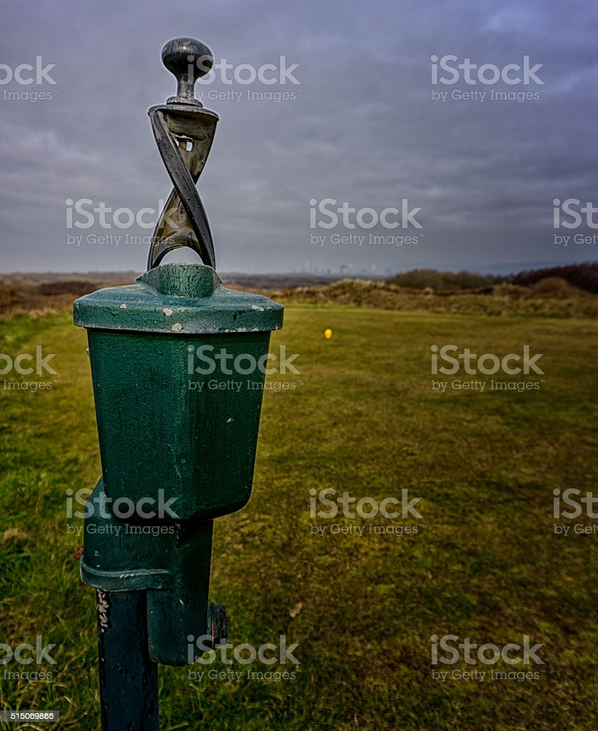 Golf ball cleaning station over teeing area stock photo