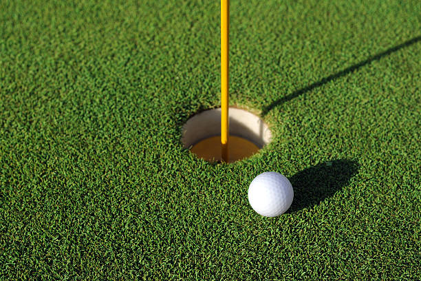Golf Ball Close To The Hole - XLarge stock photo