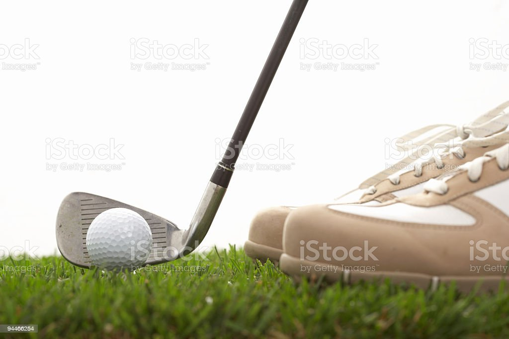 golf ball, club and brogues royalty-free stock photo