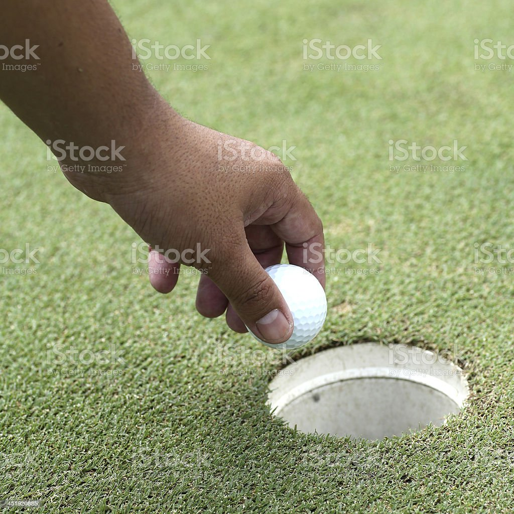 Golf ball from the hole.