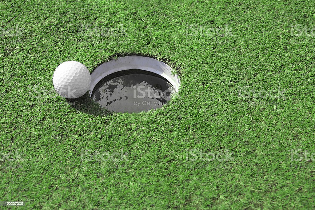 Golf ball go to the hole royalty-free stock photo