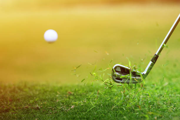 Golf Ball Hit from the Grass stock photo