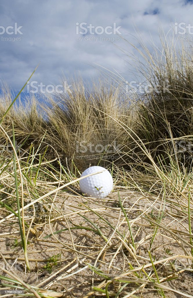 Golf ball in dunes 3 royalty-free stock photo