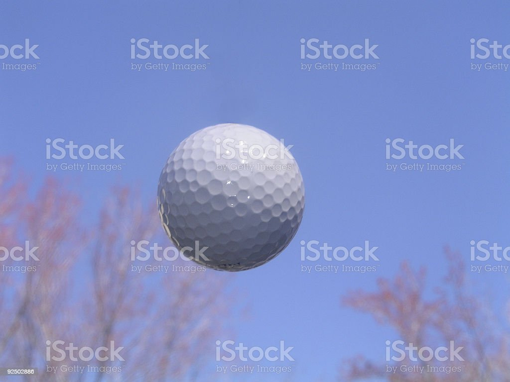 Golf Ball in Flight royalty-free stock photo