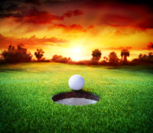 Golf Ball In Hole - Golfing stock photo