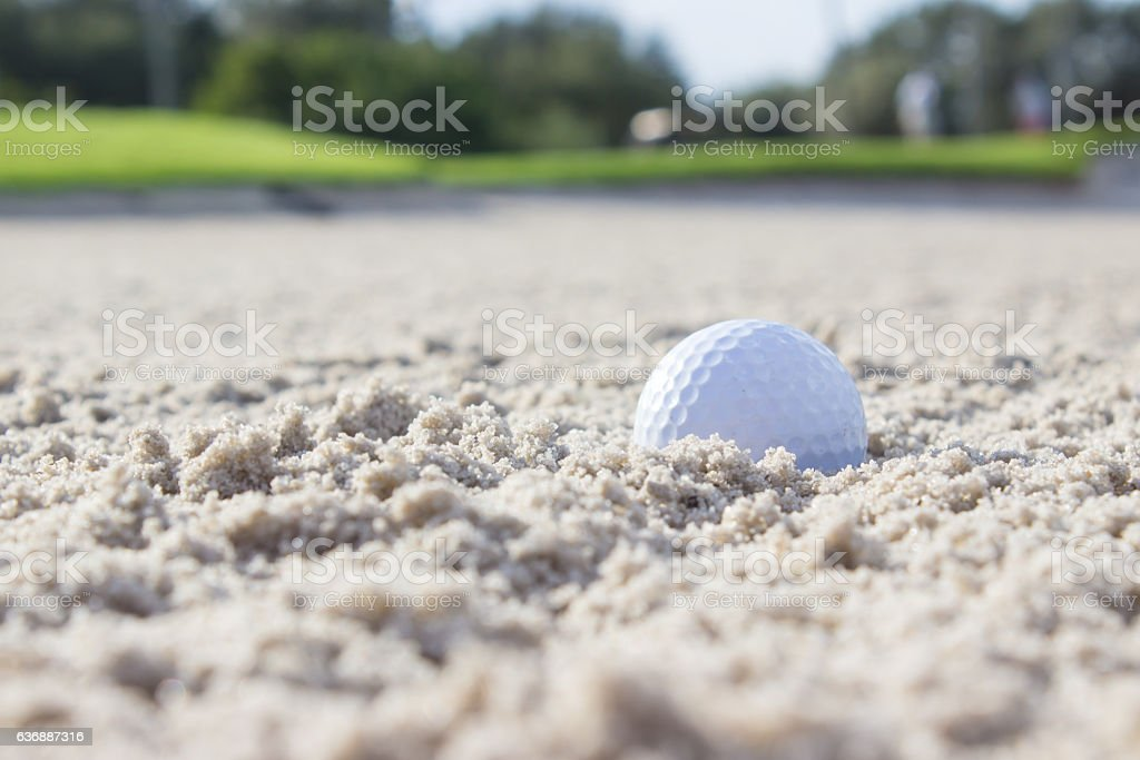 Golf Ball in Sand Trap stock photo