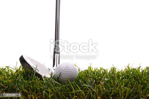 istock Golf ball in tall grass with 7 iron 1283598215