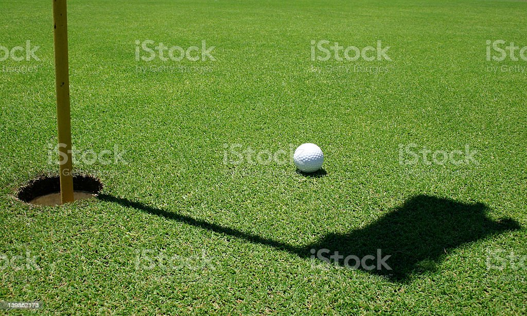 Golf ball in the green royalty-free stock photo