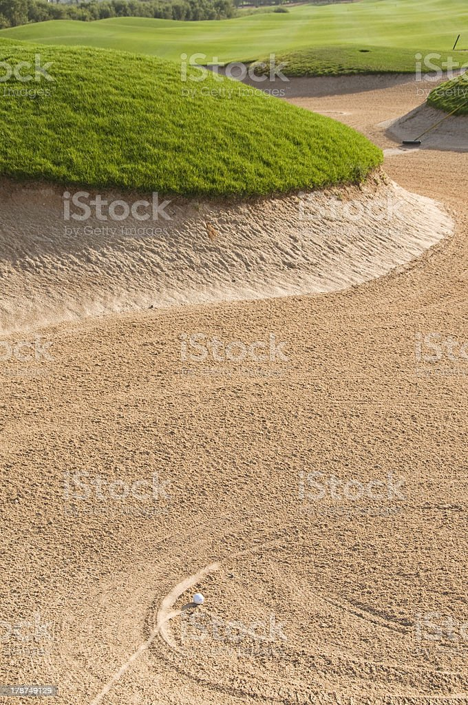 Golf ball in the sand bunker stock photo