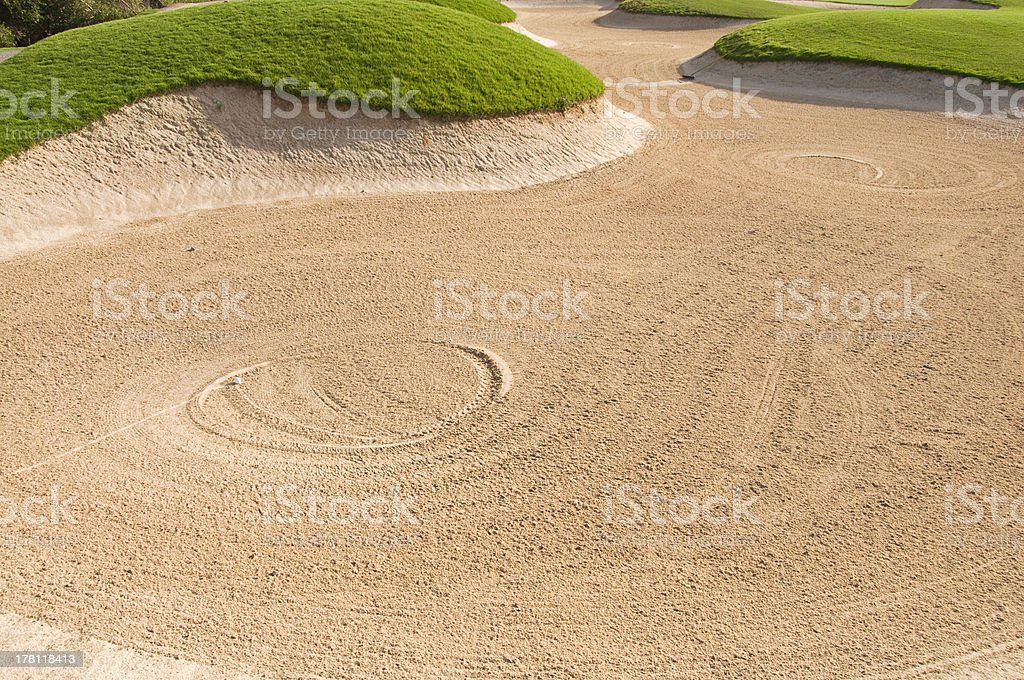 Golf ball in the trap stock photo