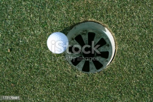 A golf ball that is just short of the hole.View more sports photos: