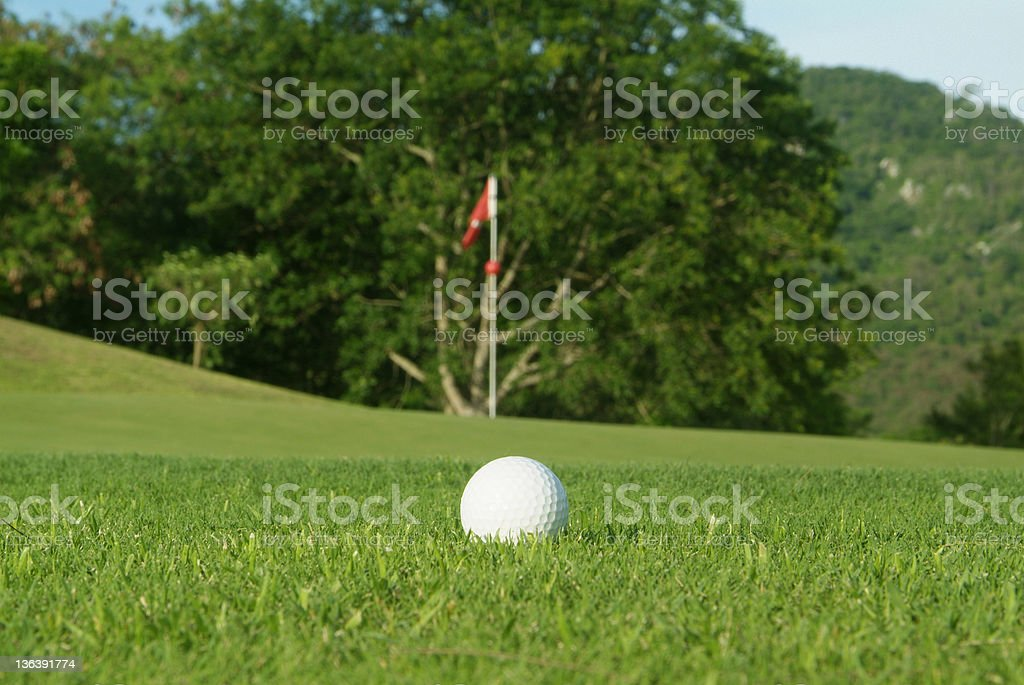 Golf ball near the green royalty-free stock photo