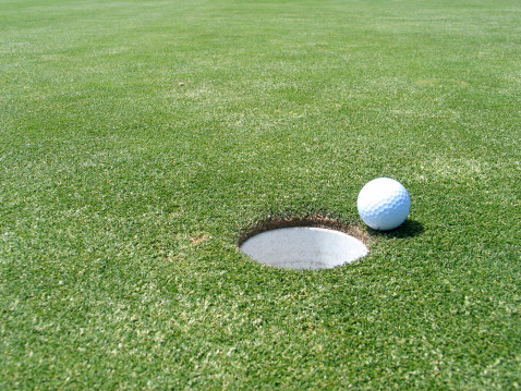 Golf Ball Near The Hole Stock Photo - Download Image Now