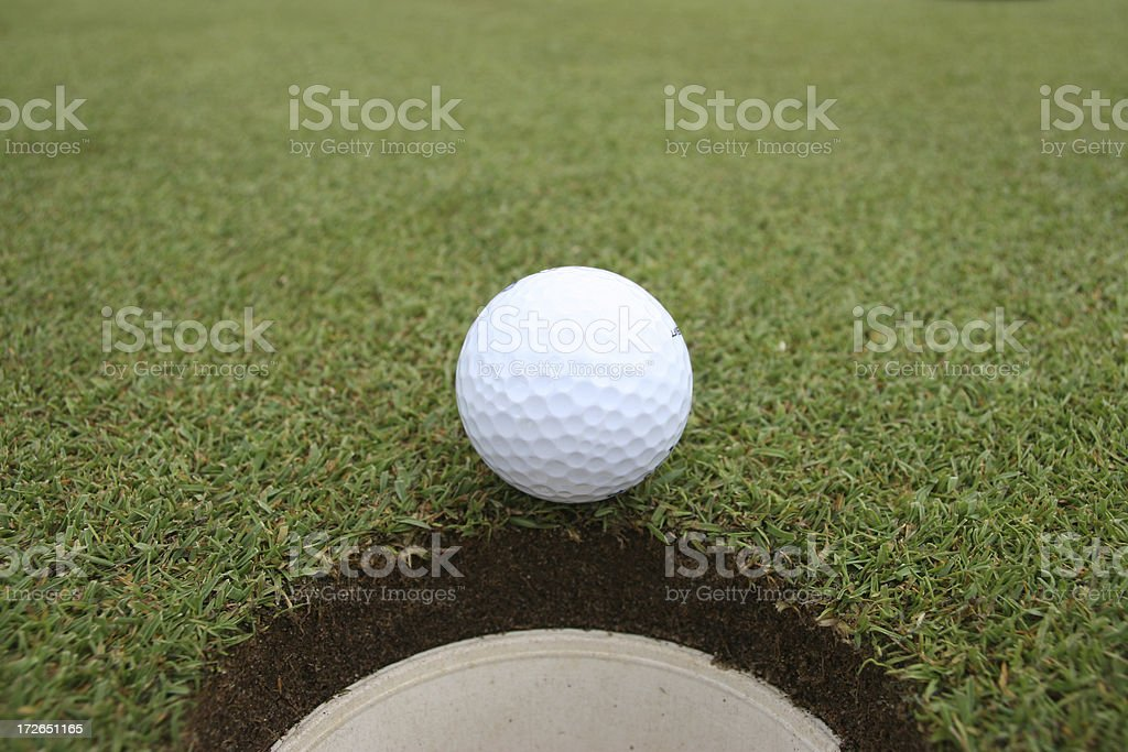 The ball stops just short of the hole.