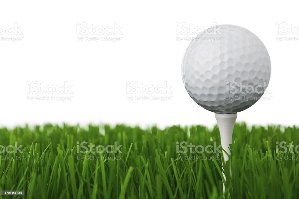 Golf ball on a tee and grass royalty-free stock photo