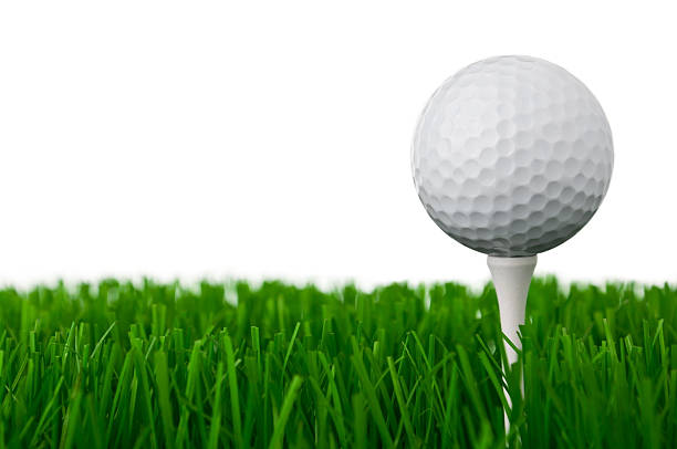 Golf ball on a tee and grass stock photo