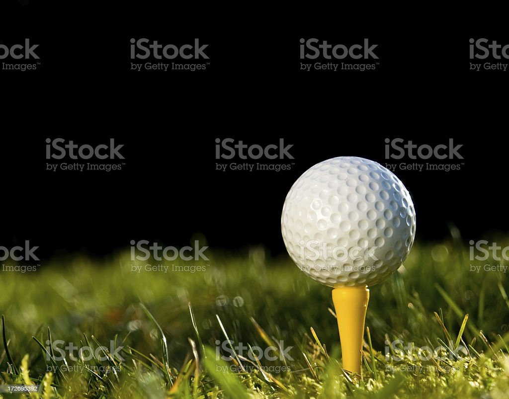 Golf Ball on a Yellow Tee royalty-free stock photo