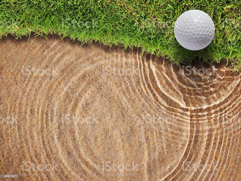 Golf ball on fresh green grass near water bunke stock photo