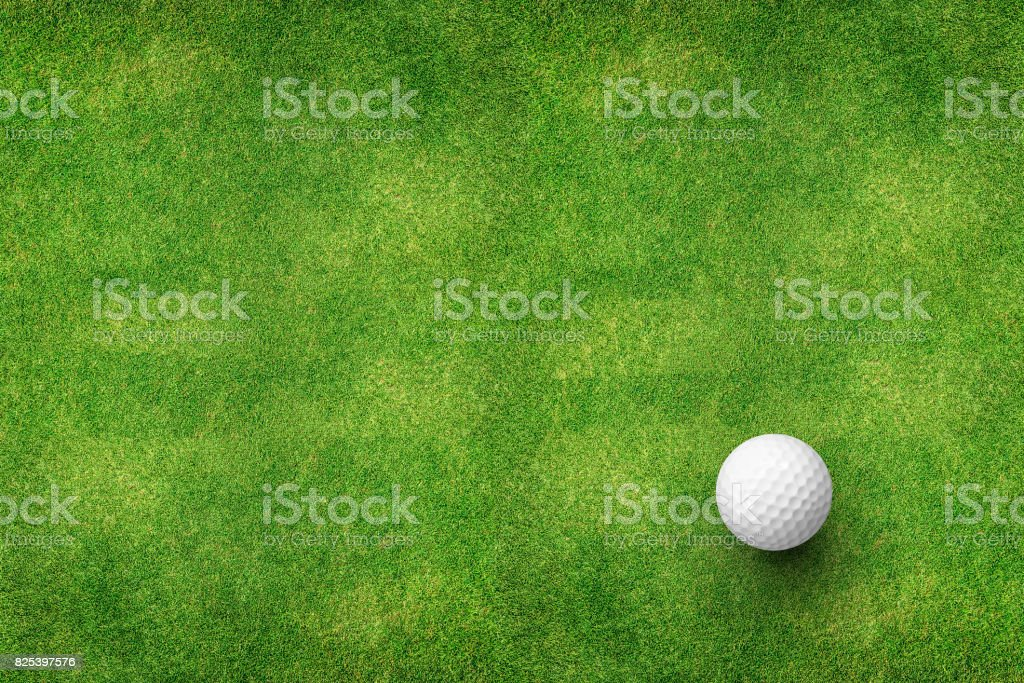 golf ball on grass top view stock photo