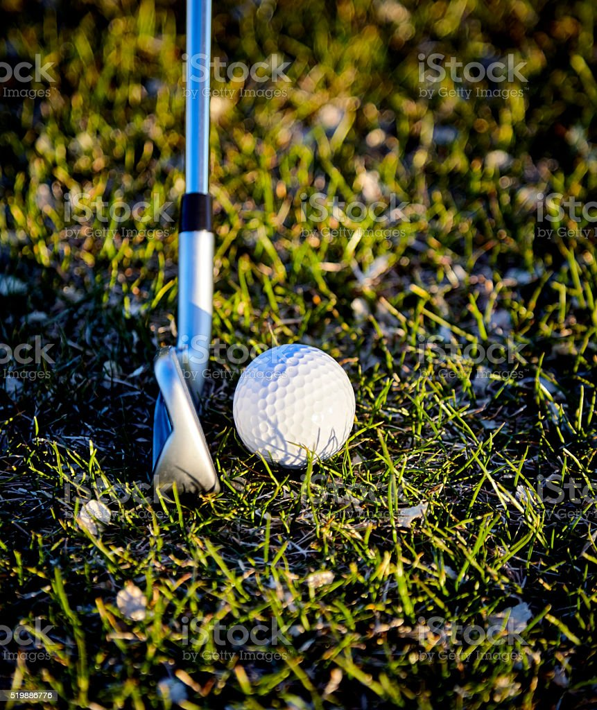 Golf Ball on Grass with Golf Club stock photo