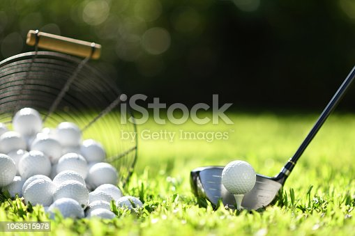 istock Golf ball on green grass ready to be struck for practice 1063615978