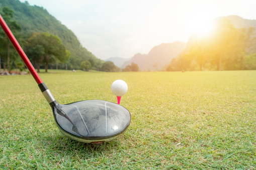 istock golf ball on green grass ready to hit from t-off in beautifull tropical golf course for background or poster. 1058375766