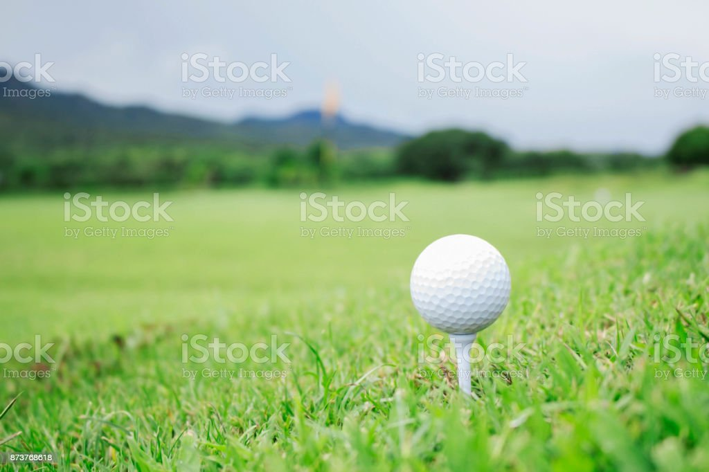 Golf ball on green lawn. stock photo