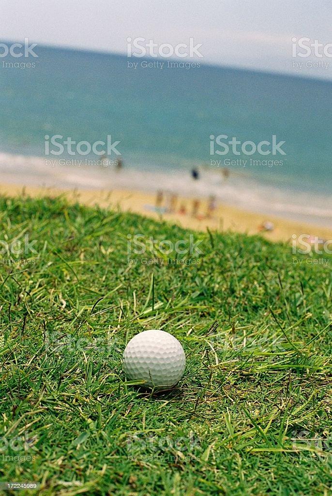 Golf ball on Hawaii beach royalty-free stock photo