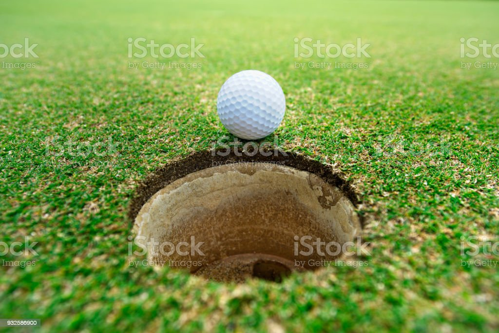 golf ball on hole..beautiful golf course on hill in big club. Golf...